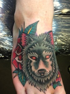 Traditional Wolf tattoo on foot